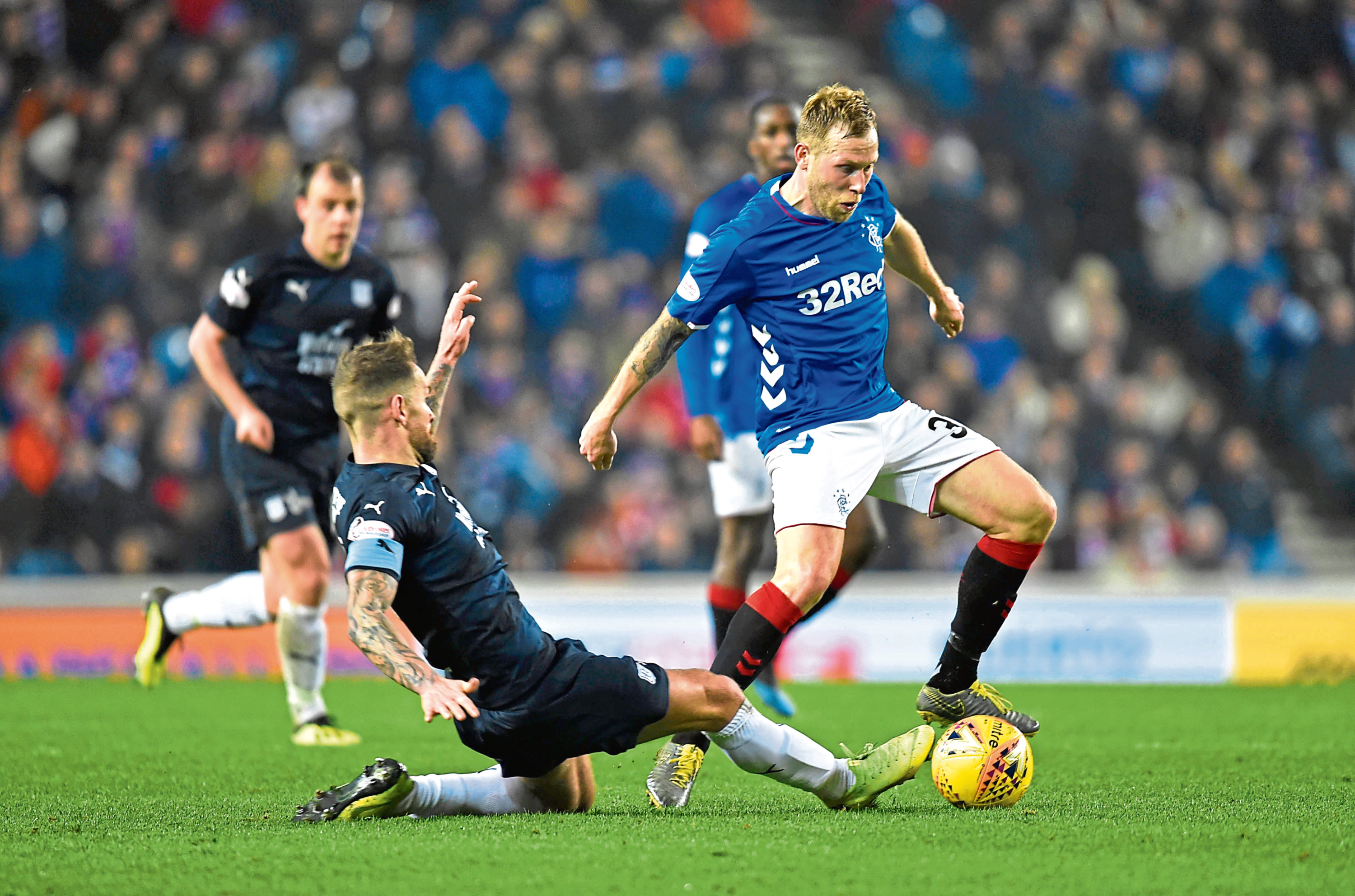 Rangers' Scott Arfield (right) dodges a challenge from Dundee's Martin Woods