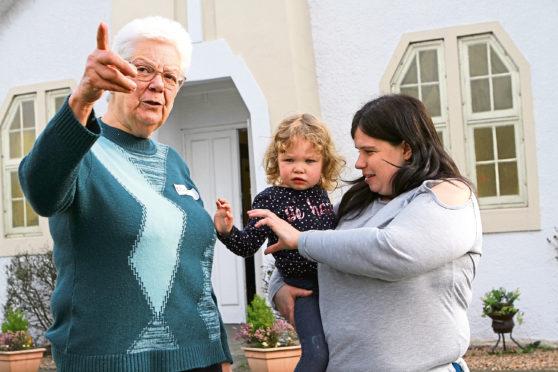 Rhona Armitage, left, with Kelly McMillan and her two-year-old daughter Robyn