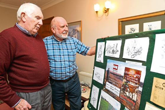 Robert, left, with his brother Jim Murray, who illustrated the book