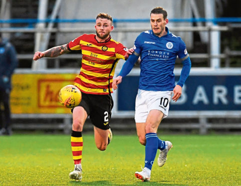 Josh Todd battles for the ball with Christie Elliot of Partick Thistle