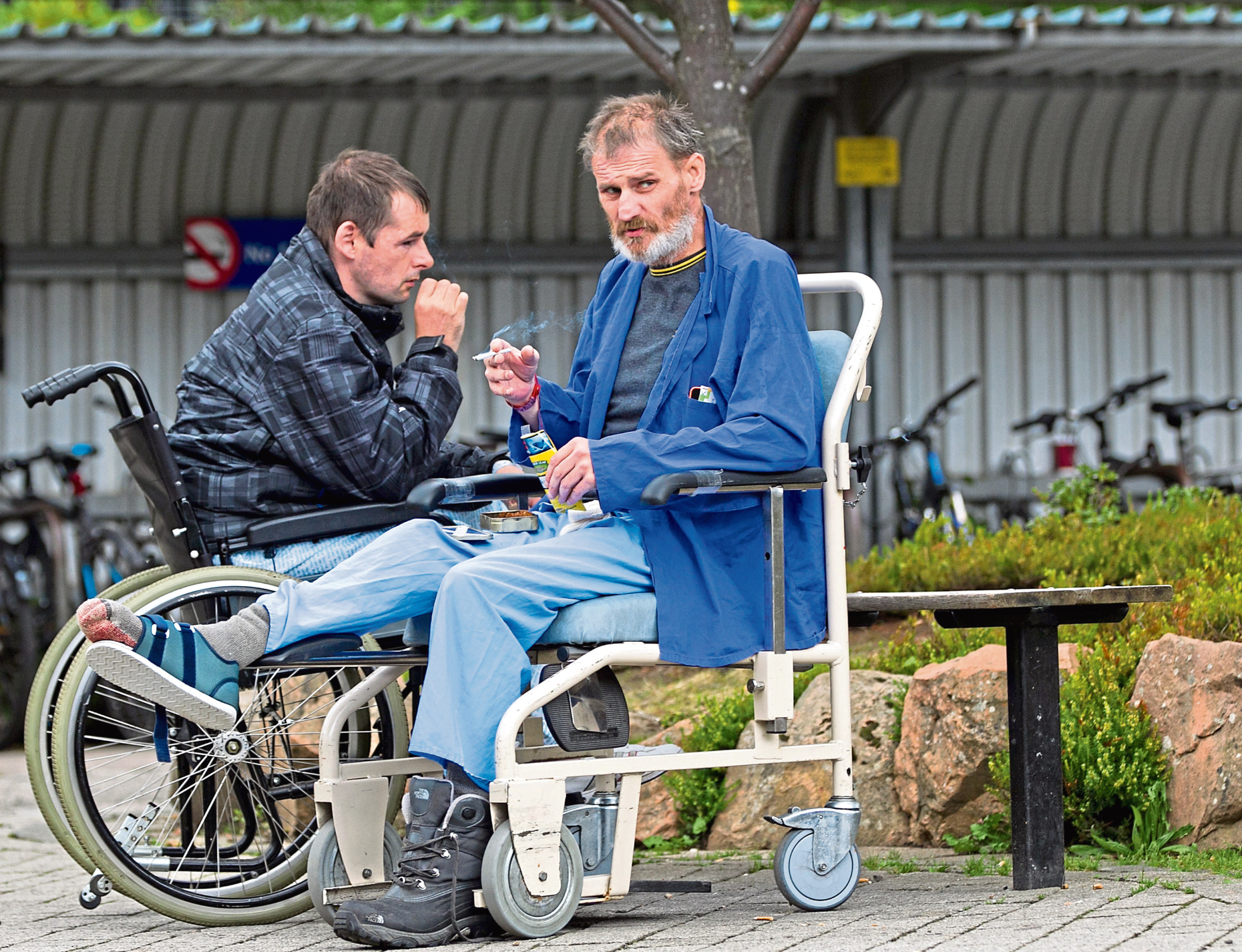"""2/9/2015. Sunday Post. Andrew Cawley. Pics of people smoking on hospital grounds, where it is not allowed. Pic shows smokers in the """"Fresh Air Garden"""" near the entrance to Ninewells Hospital, Dundee"""