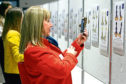 Visitors admire the designs for the Oor Wullie Big Bucket Trail