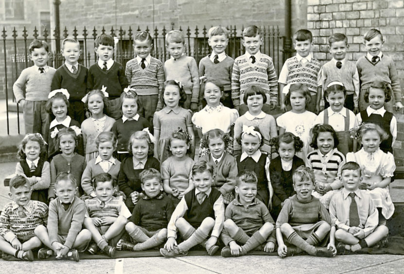 A Primary 1 class in 1952. Back row: L-R Frances, Graham Moore, Ian Blues, Ian Clapperton, Brian Thomson, Ronald Keenan, David Kettles, Douglas McIntyre Second back row: Darl Spittle, Christine Mitchell, Sally Mason, Caroline Chambers, Wendy Scott, Espeth Adason, Joyce Peddie, Sandra Campbell, Marion Webster Second front row: Sheila Husband, Moira Anderson, Jean Ramsay,, Jean Robertson, Avril Westen, Lorna Morrison, Wilma Sword, Roberta Reilly. Front row: Ian Mac, Alan Clark, Ian Mac Donald, John Martin, John Beattie, Raymond Rice, Brian Ross