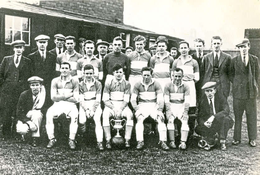 An unknown sports team sent in by a Mrs McRae