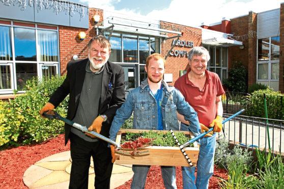 Chairman of the Ardler Environment Group Graham Cross with members Kristofer Stevenson and David Milne