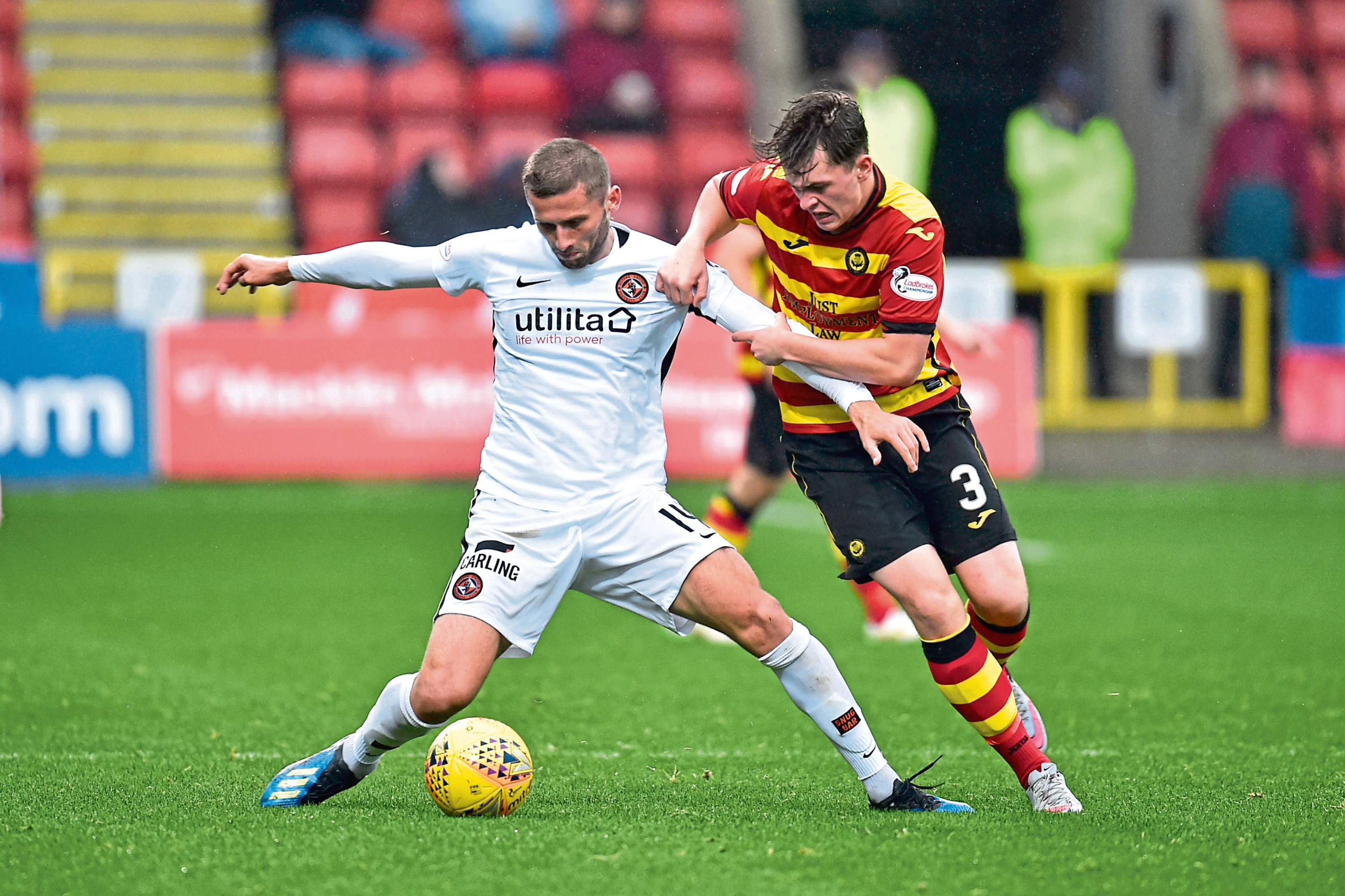 United's Pavol Safranko and Partick's James Penrice in October