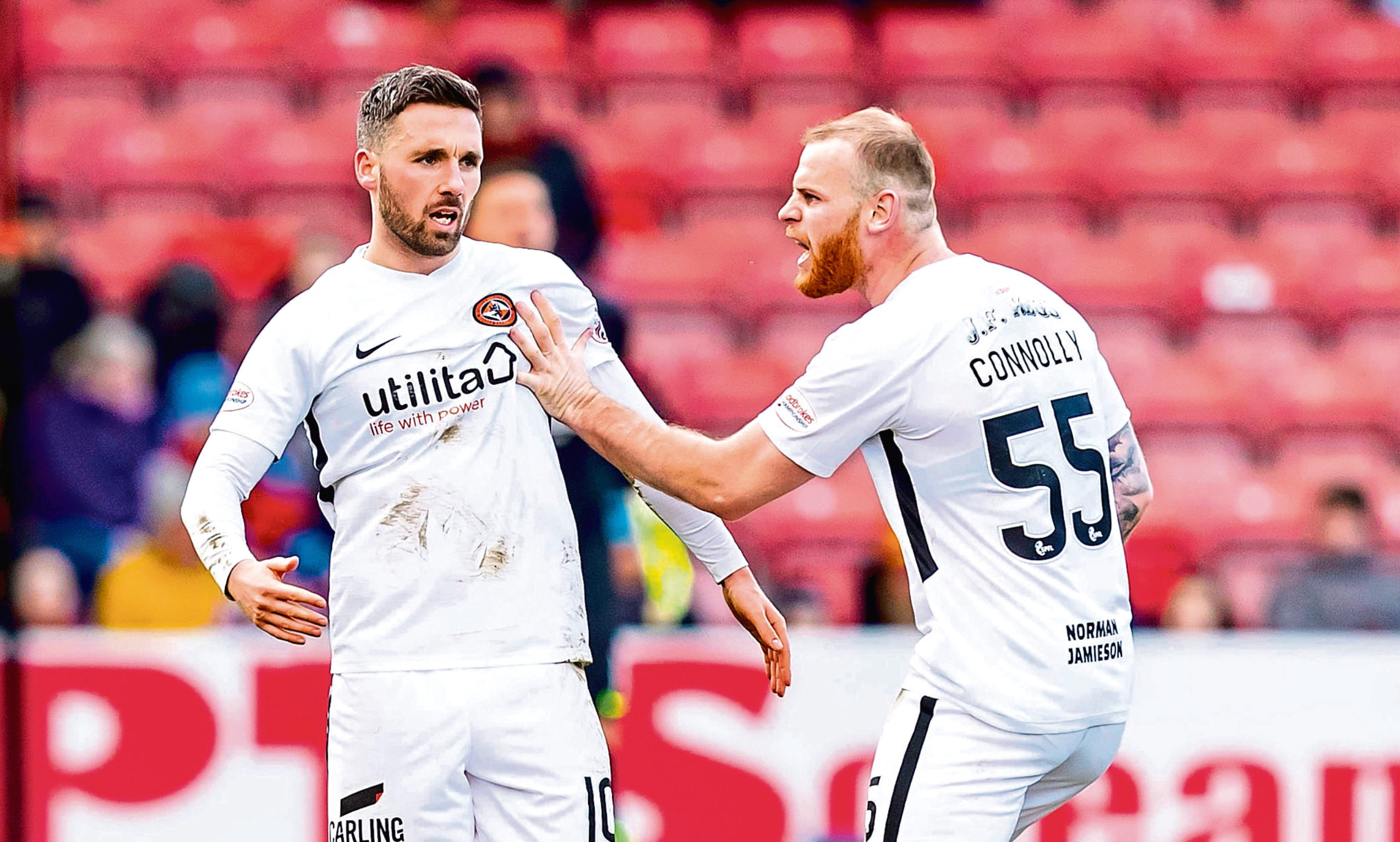 Dundee United's Nicky Clark celebrates his goal at Partick Thistle with Mark Connolly