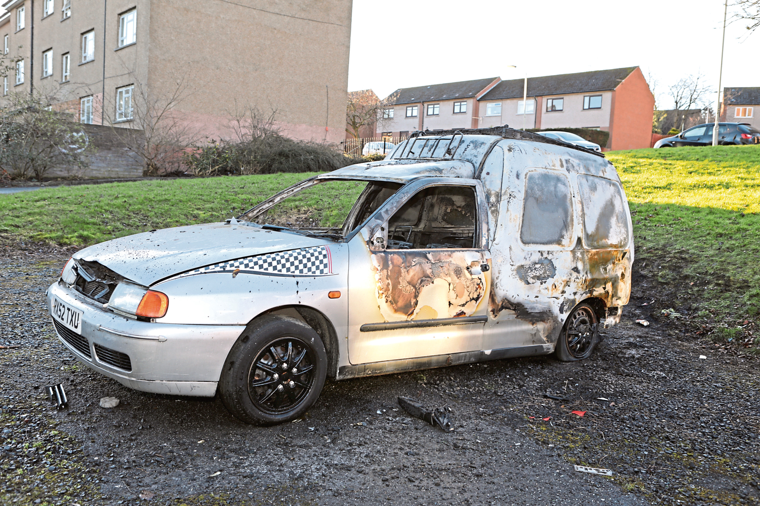 The burnt-out VW Caddy van on Forth Crescent