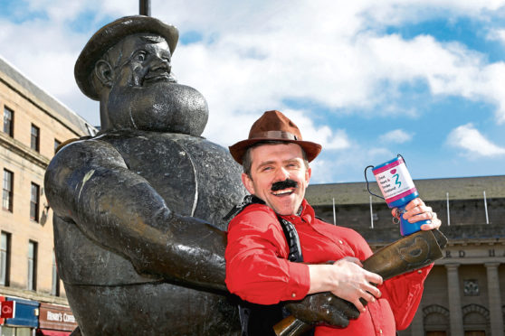 Lawrence Cowan of Chest Heart & Stroke Scotland dressed up as – and with – his hero Desperate Dan.