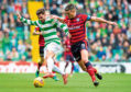 Dundee's experienced defender Darren O'Dea is challenged by Celtic's                               on-loan winger Patrick Roberts during a hard-fought 0-0 draw at Dens Park in April 2016