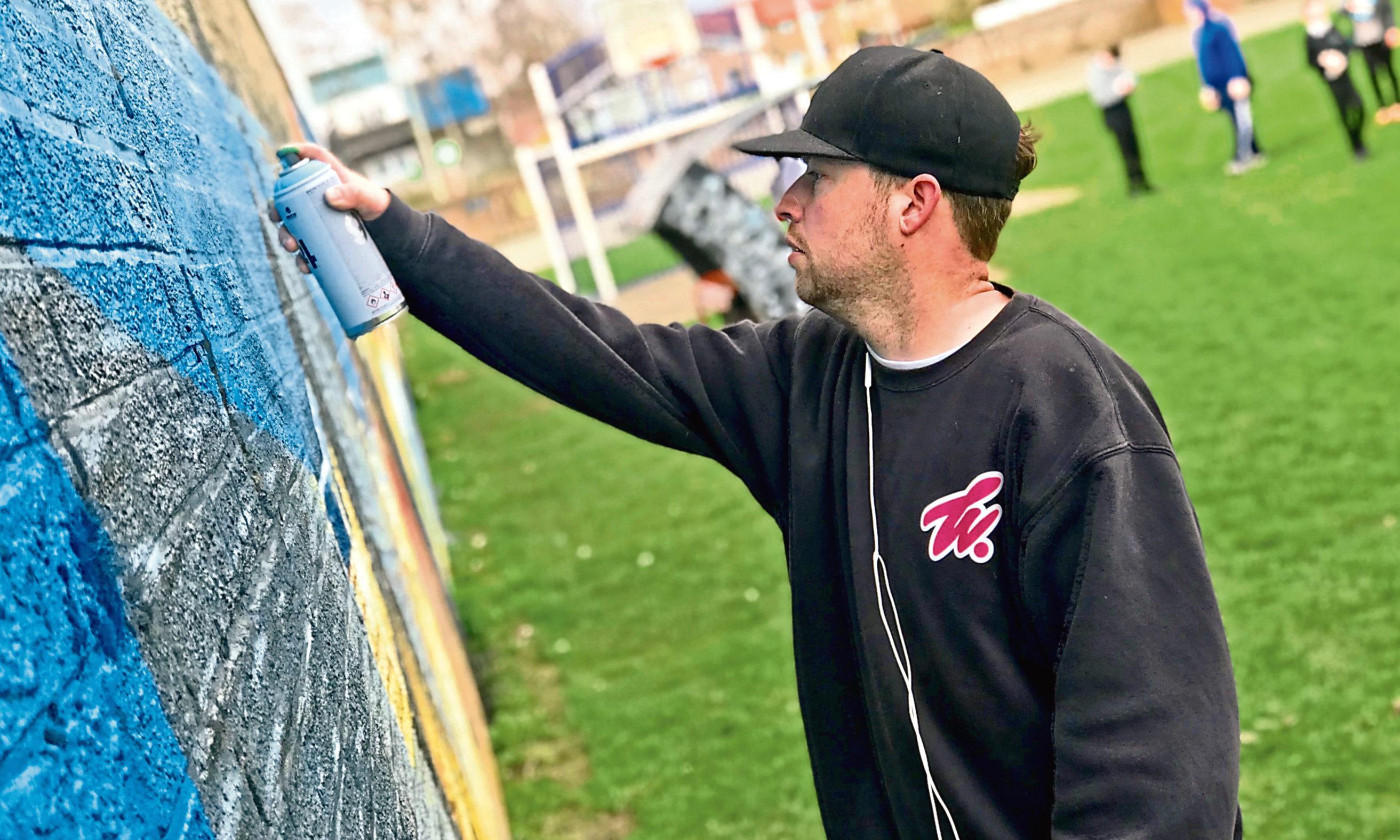 Graffiti artist Adam Milroy.