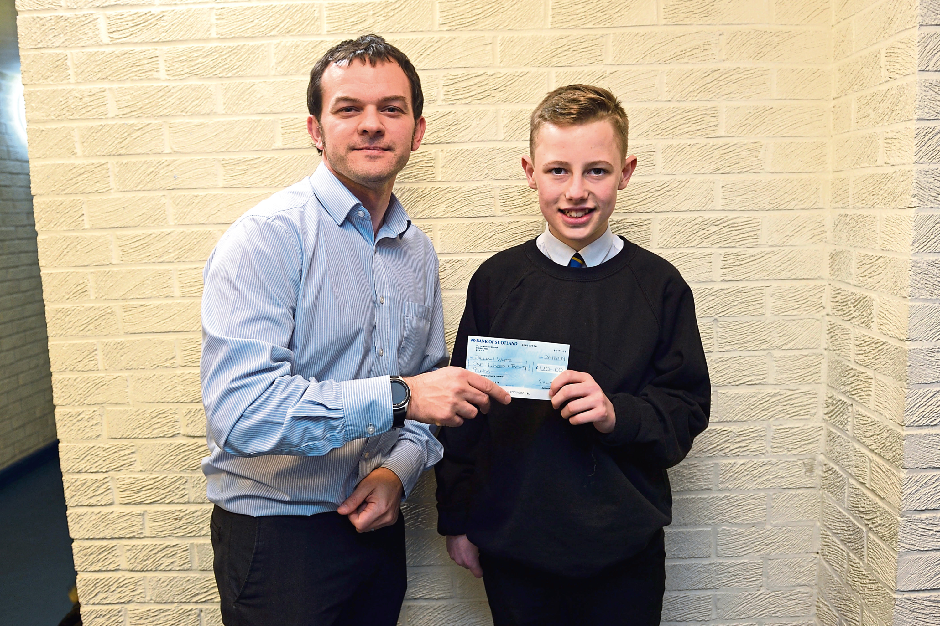 Golfer Lawrence Whyte (right) receives a sponsorship cheque from Perth and Kinross Sports Council, represented by Bruce Gibb
