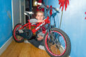 Telegraph News - Dundee - Greg Flucker story; CR0007147 A Dundee Taxi driver got in touch with us to help return a lost child's bike. We reunited the bike with it's owner. Picture Shows; Michael Garbacova (8), Pitalpin Court, Dundee, 16th March 2019. Pic by Kim Cessford / DCT Media