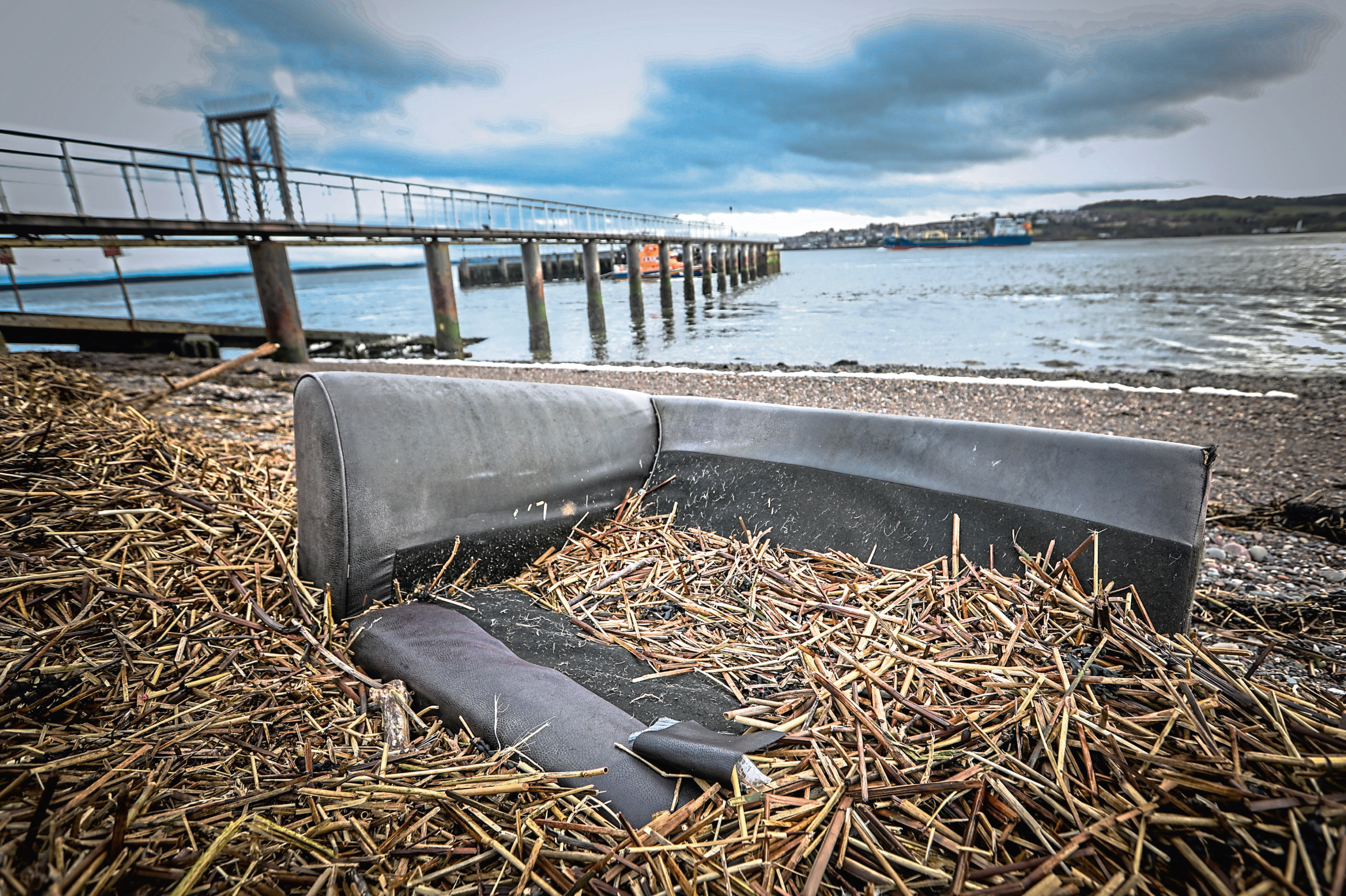 A sofa and a tyre have been fly tipped on Broughty Ferry Beach