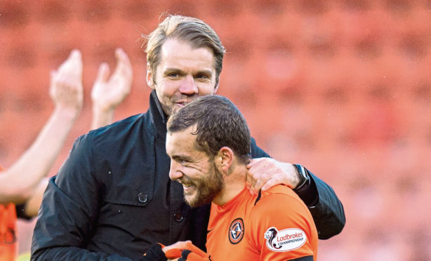 Dundee United manager Robbie Neilson and Paul McMullan.