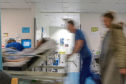 EFNXNJ A busy hospital with doctors, nurses and staff busy at work in an accident and emergency ward in a British hospital
