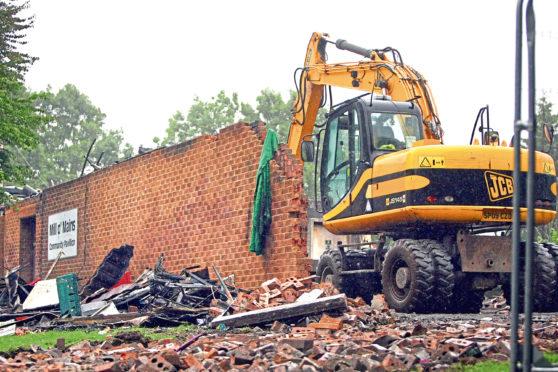 Demolition work at the pavilion after a fire destroyed it.
