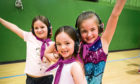 Jenny Robertson, Freya Jrdan and Lilyava Heam from 30th Dundee Brownies (Barnhill) enjoying the silent disco at Douglas Sports Centre.