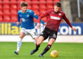 St Johnstone's Matty Kennedy and St Mirren's Jack Baird during a tie in October last year.