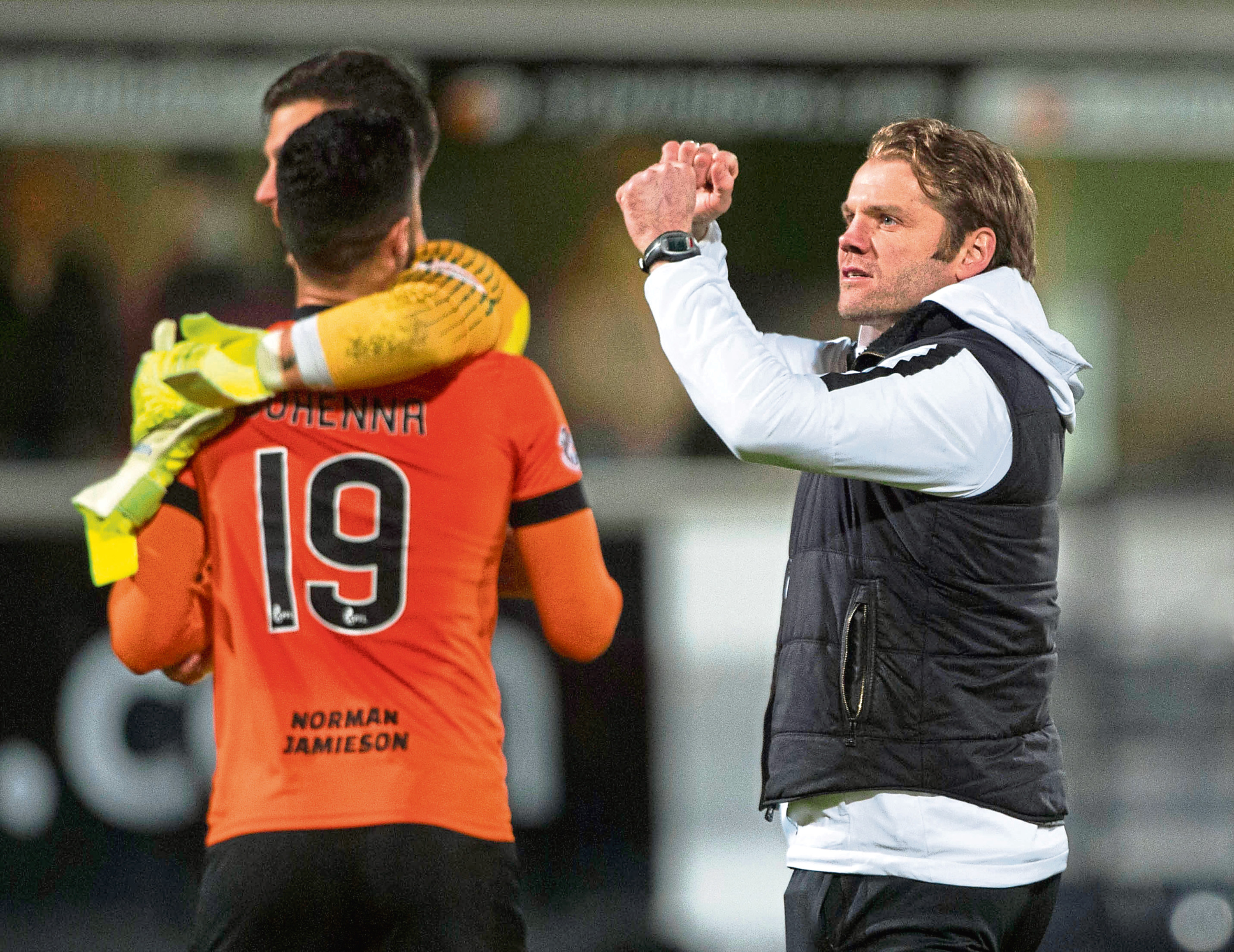 Dundee United manager Robbie Neilson celebrates at full-time.