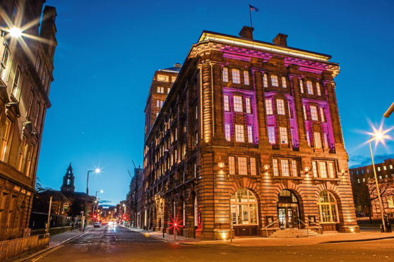 DC Thomson's Dundee headquarters illuminated in purple for Epilepsy Awareness.