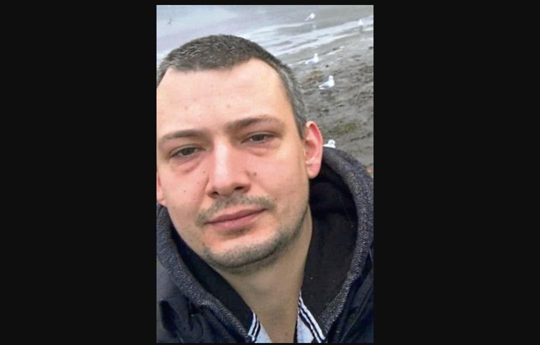Arkadiusz Pflagel spat on and slapped the woman