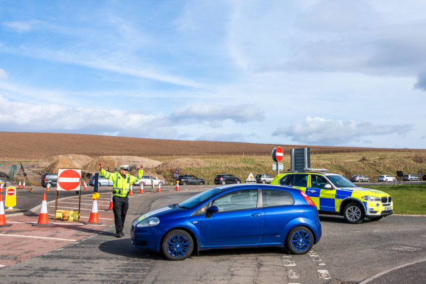 Police direct northbound traffic at Bankfoot junction on the A9