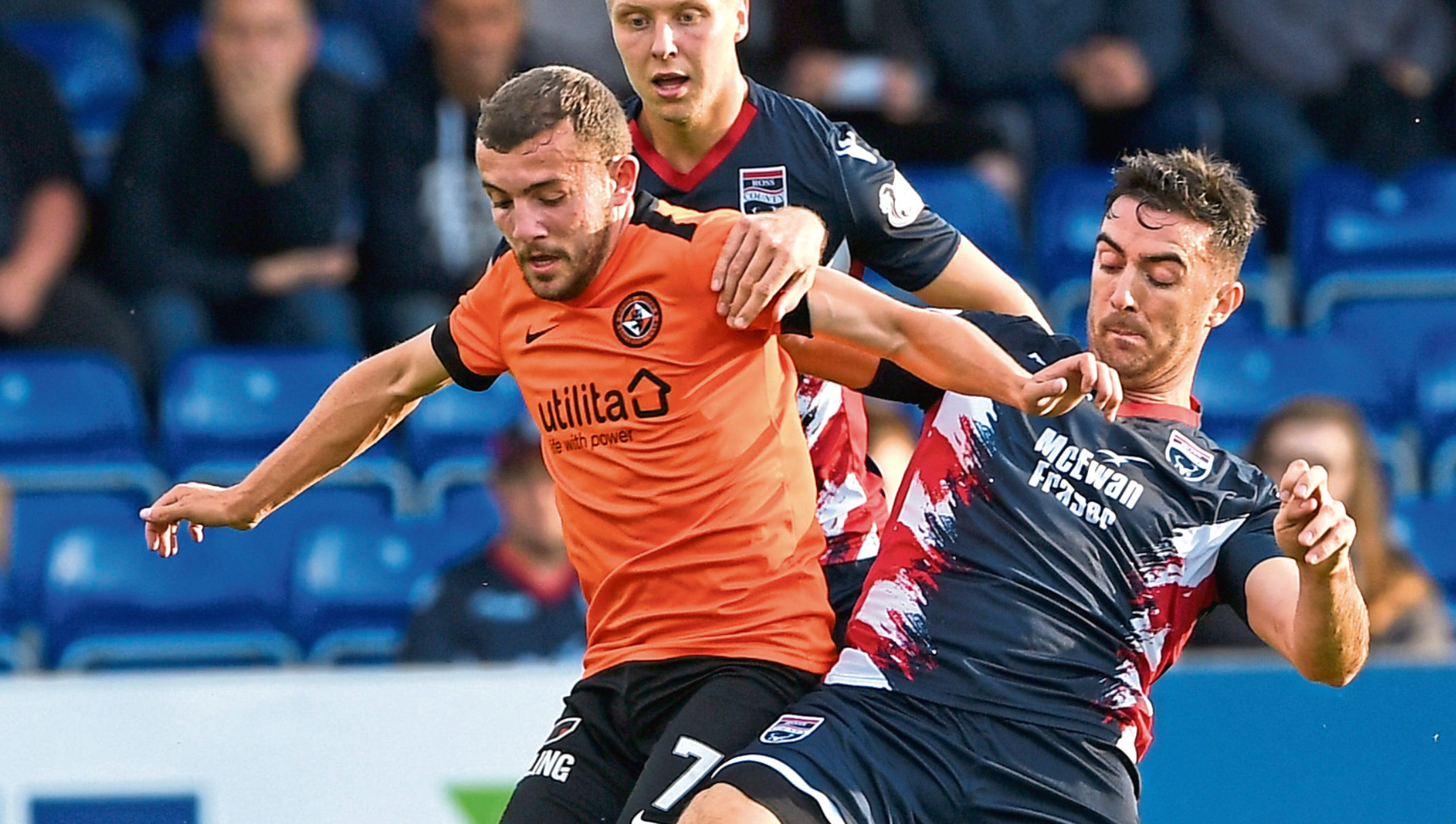 Dundee United's Paul McMullan challenges Ross County's Ross Draper