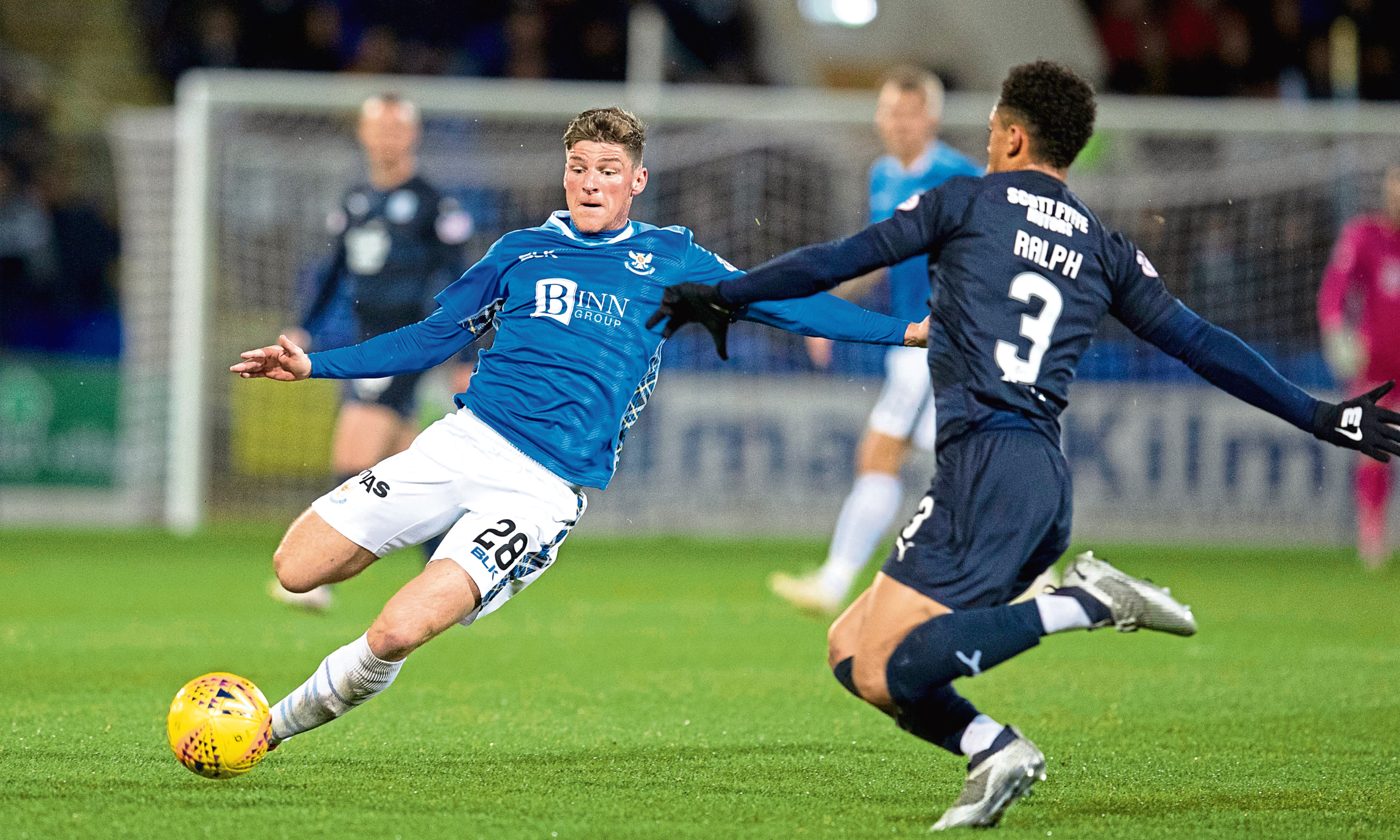 St Johnstone midfielder Ross Callachan and Dundee left-back Nathan Ralph compete for the ball during Saints' 2-0 victory over the Dark Blues