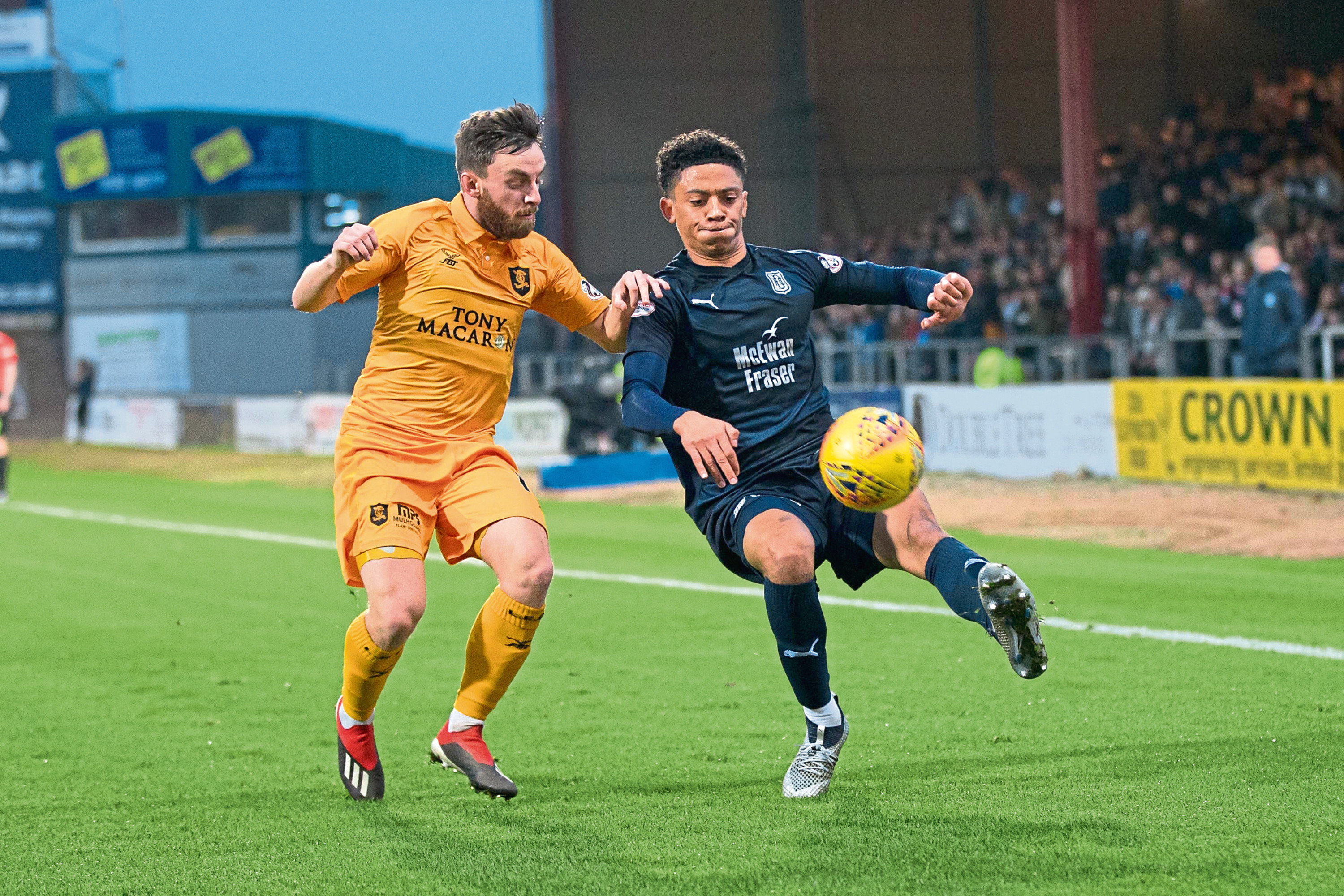 Nathan Ralph of Dundee takes on Steven Lawless of Livingston