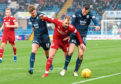 Dundee defender Ryan McGowan (right) and Sunderland kid Ethan Robson crowd out Aberdeen attacker Niall McGinn in Saturday's 2-0 loss at Dens Park.