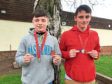 Cadet Dylan Young,16, St Mary's Black Watch Detachment, Dundee and Cadet Ethan Torrie, 15, from Carnoustie Black Watch Detachment, with their silver medals.