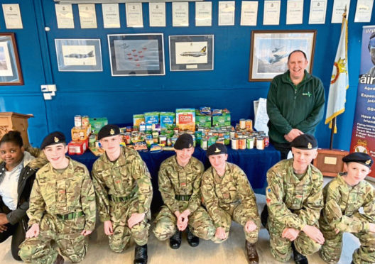 Some of the cadets with the food they collected to donate.