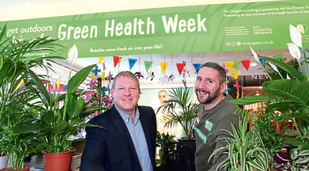 Malcolm Angus, centre manager of the Overgate and Barry Mcruvie, customer services assistant, have launched the Green Health Week information point at the customer services desk.