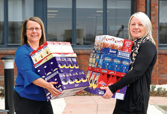 Stacey, right, collecting the Easter eggs from Gillian Beattie of Tesco.