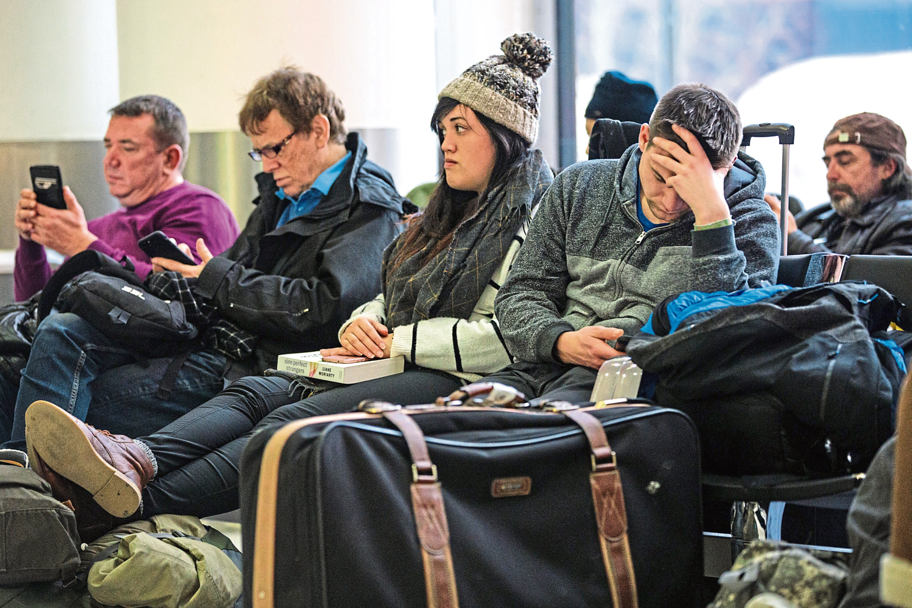Passengers wait in the South Terminal building at London Gatwick Airport after flights resumed today on December 21, 2018 in London, England.