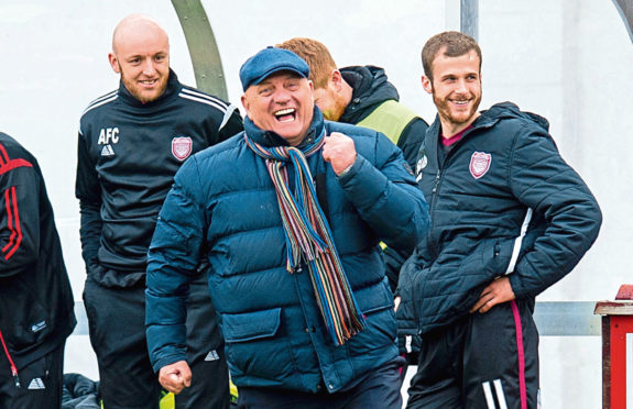 Arbroath manager Dick Campbell celebrated promotion to the Championship after a draw against his former club, Brechin City.