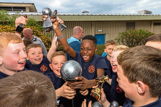 n Picture shows the Fairmuir team celebrating with the trophy.