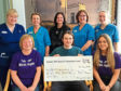 Pictured are (front) relative Janice Sturrock, Mickey and Suszi and (rear) Alison, Mickey's girllfriend Clair Robb and staff from ward 32.