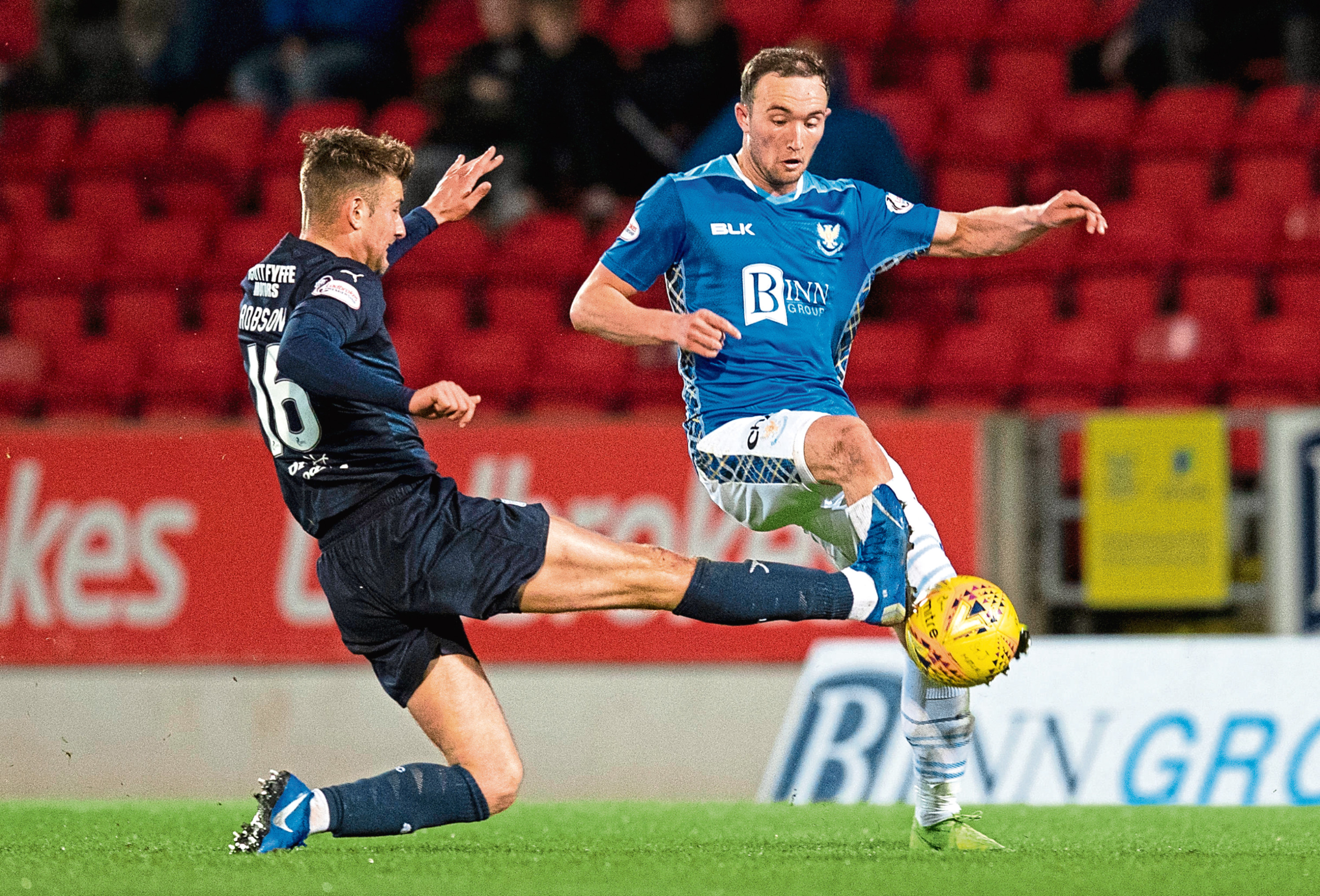 St Johnstone striker Chris Kane takes on Dundee's Ethan Robson earlier this month at McDiarmid Park.