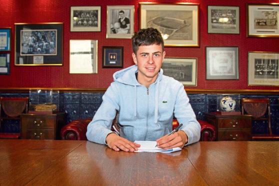 Callum Moore signs a new deal at Dens Park.