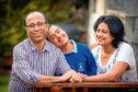 Aaryan Banerjee (centre) alongside dad Subhayu Banerjee and mum Pronita Banerjee