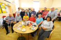 Some of the service users, staff and volunteers at Mid-Lin Day Care