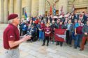 Tam Whitton addresses the crowd in City Square.