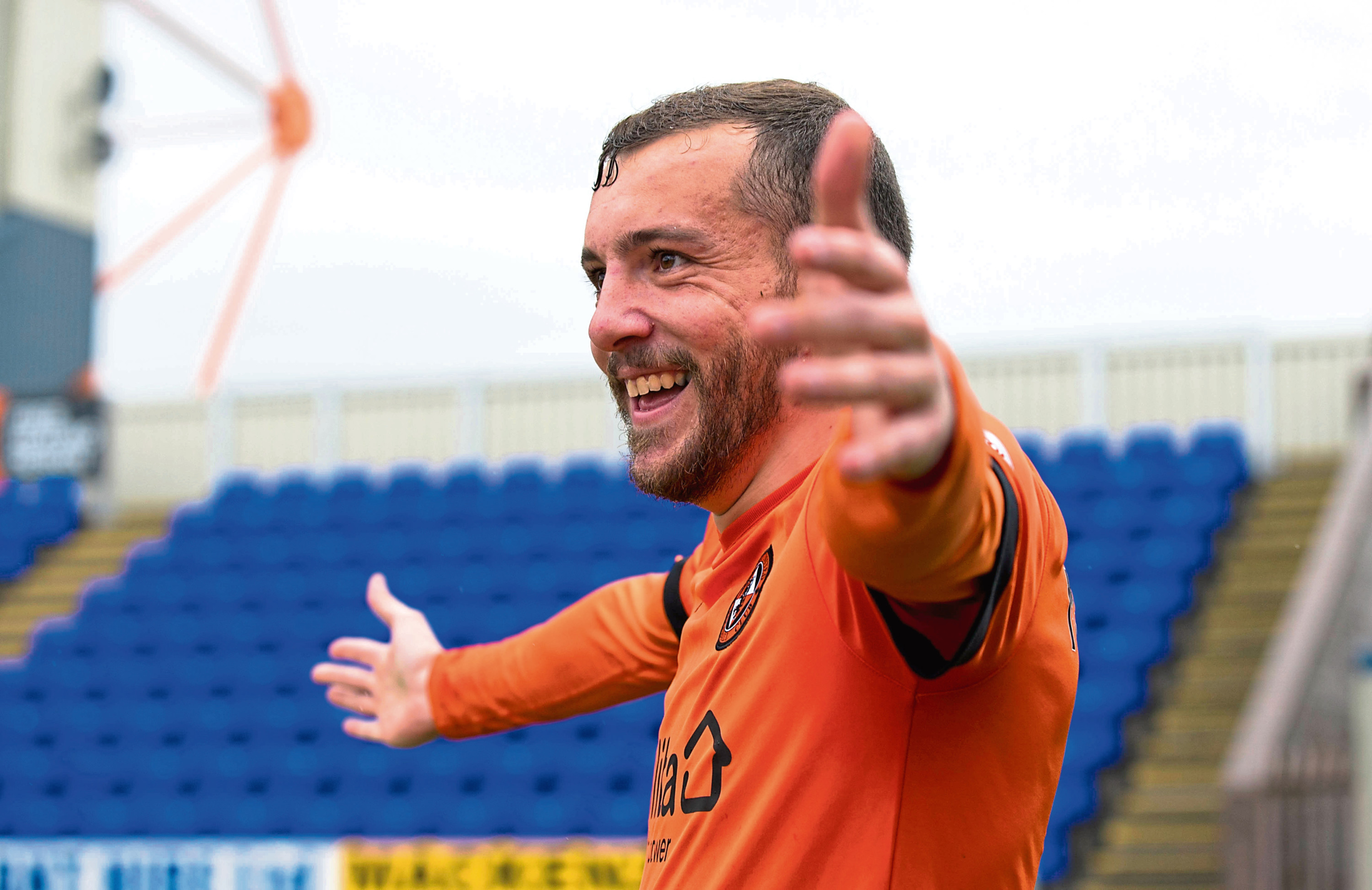 Dundee United's Paul McMullan celebrates his goal to make it 2-0 at Inverness.