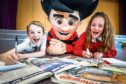 Two of the Tele Takeover team, Blair Taylor-McNeil and Emma Van Der Kaay, both 11, with Dennis the Menace.
