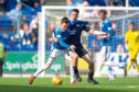 Dundee's Cammy Kerr challenges for the ball with Danny Swanson of St Johnstone.