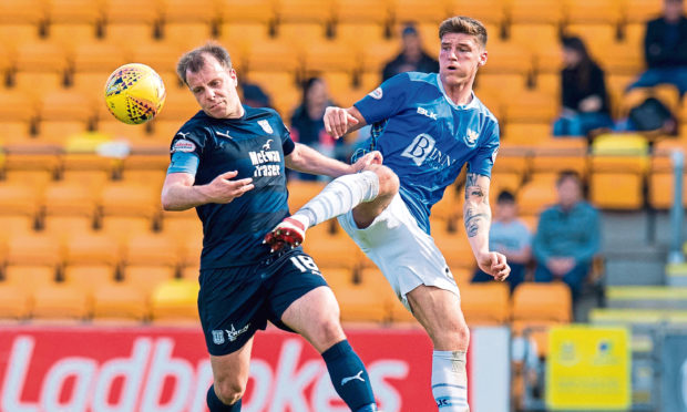 Ross Callachan in action for St Johnstone last season against Dundee's Paul McGowan.