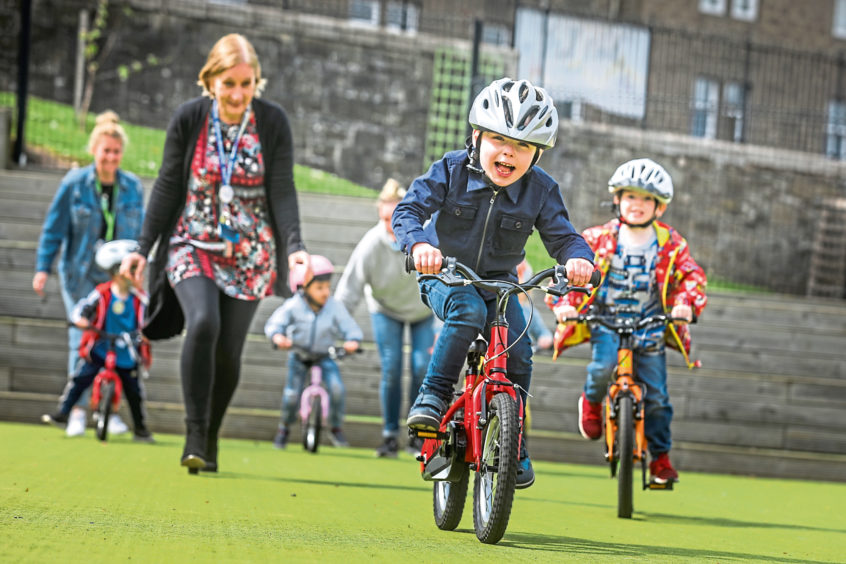 Theo Mitchell, 5, leading the way on his bike