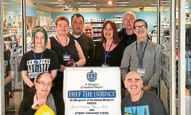 Staff from St Margaret of Scotland Hospice Charity Shop